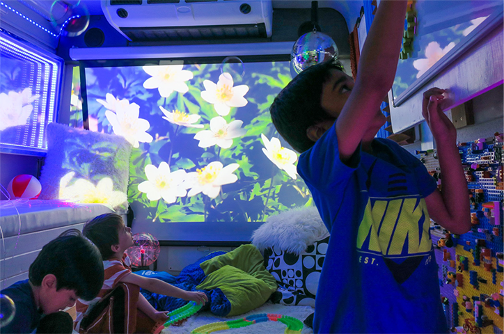 Three kids playing in a sensory room
