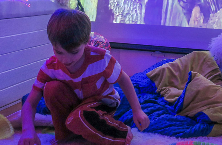 A child playing in a sensory room