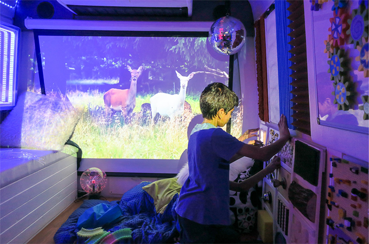 Two kids playing in a sensory room